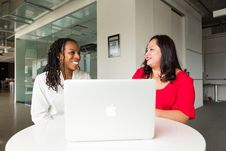Free Two Women In Front Of Silver Macbook Royalty Free Stock Photo - 119844715
