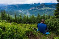 Free Man Wearing Blue Shirt Sitting On Green Grass Royalty Free Stock Photography - 119844767