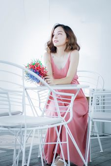 Free Woman In Pink Dress Sitting On Chair Stock Images - 119844894