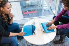 Free Two Women Browsing On Laptop Computers Royalty Free Stock Photos - 119926168