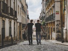 Free Two Man Walking In Between Of Buildings Toward With Concrete Building Stock Images - 119926234