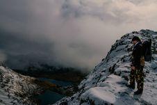 Free Hiker On Rocky Mountain Overlooking Valley Stock Photos - 119926263