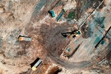 Free Aerial View Photography Of Utility Vehicles On Brown Soil Royalty Free Stock Images - 119926319