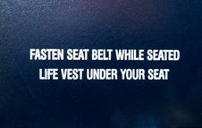 Free Fasten Seat Belt While Seated Life Vest Under Your Seat Text Overlay Stock Image - 119926361