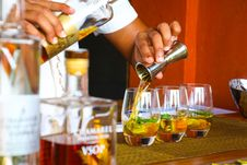 Free Person Poring Cocktail On Clear Drinking Glass Stock Image - 119926371