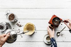 Free Person Holding Gray Teapot Pouring White Cup Royalty Free Stock Photos - 119999808