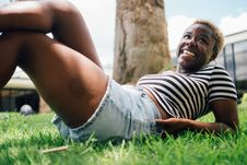 Free Woman Wearing Black And White Striped Shirt Lying On Green Grass At Daytime Royalty Free Stock Image - 119999876