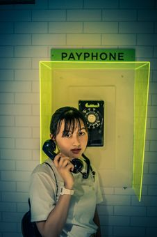 Free Woman At The Payphone Stock Photo - 119999910