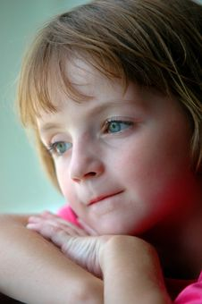 Window Portrait Of Little Girl Looking Out Window Stock Photo