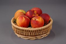 Peaches In A Basket Stock Photo