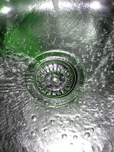 Flowing Green Water In Sink Stock Photo