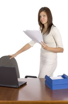 Standing Businesswoman Keeps Papers Royalty Free Stock Photos