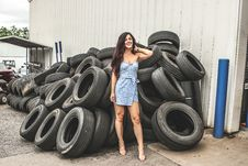 Free Woman Posing In Front Of Tires Stock Photos - 120074753