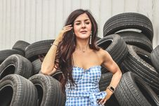 Free Woman Standing In Front Of Car Tires Royalty Free Stock Image - 120074756