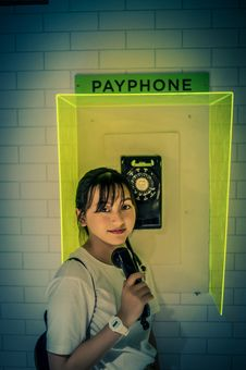 Free Photo Of Woman Standing Beside Payphone. Stock Photos - 120074763
