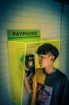 Free Boy Holding Payphone Receiver Royalty Free Stock Photo - 120074775