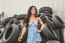 Free Woman Wearing Blue Flannel Dress Standing In Front Car Tires Royalty Free Stock Photo - 120142565