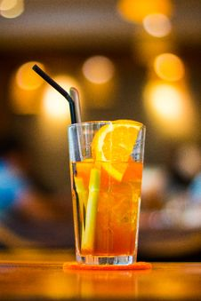 Free Clear Drinking Glass Filled With Orange Juice With Black Straw Royalty Free Stock Images - 120142589