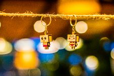 Free Two Brown Wooden Character Keychains Hanged On Brown Rope Stock Image - 120142591