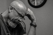 Free Grayscale Photo Of Man Thinking In Front Of Analog Wall Clock Stock Image - 120142611