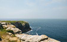 Free Gray Rock Mountain Cliff Near Sea Photo Taken Royalty Free Stock Photography - 120264347