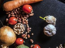 Free Variety Of Spices And Vegetables On Black Surface Stock Image - 120361001