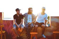 Free Three Men Sitting On Veranda Royalty Free Stock Photos - 120361038