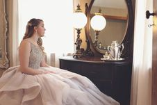 Free Woman Wearing Gown Looking At Mirror Royalty Free Stock Photography - 120361047