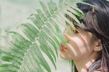 Free Close-Up Photography Of Woman Near Fern Stock Image - 120361071
