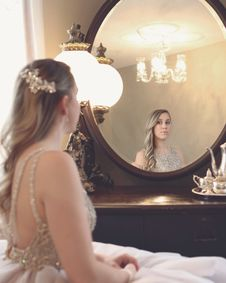 Free Woman Looking At Mirror Royalty Free Stock Photo - 120361135