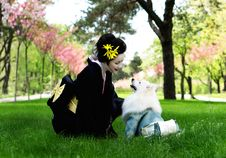 Free Woman In Black Kimono Looking At White Japanese Spitz Royalty Free Stock Photo - 120462565
