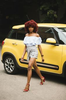 Free Woman Wearing White Off-shoulder Blouse Standing Next To Yellow Fiat 500l Royalty Free Stock Photos - 120462688