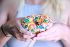 Free Person Holding Doughnut With Toppings Royalty Free Stock Photo - 120462695