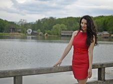 Free Woman Leaning On Bridge Bar Near Body Of Water Royalty Free Stock Photography - 120524107
