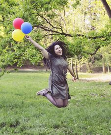 Free Woman Jumping While Holding Four Balloons Stock Photo - 120524120