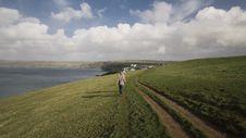 Free Woman Walking On Green Grass Field Stock Image - 120524141