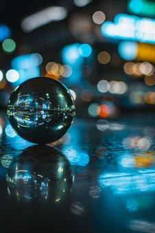 Free Glass Ball With Reflection Of Lighted Building Stock Photo - 120524150