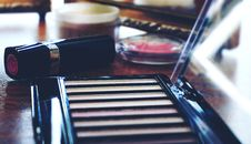 Free Lipstick Near Eyeshadow Palette Stock Image - 120524161