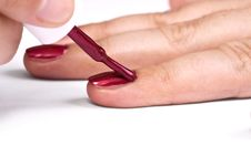 Painting Her Nails Royalty Free Stock Image