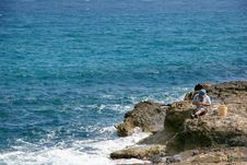 Free Fishman On The Rocks, Crete Royalty Free Stock Photography - 1210457