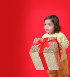 Free Toddler With A Christmas Gift Royalty Free Stock Image - 1216866