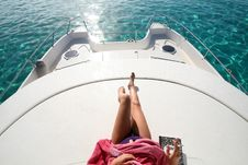 Woman Legs On A Boat Stock Photos