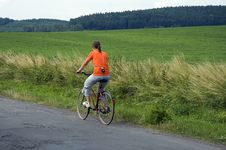 Girl Riding Bicycle In Country Stock Images