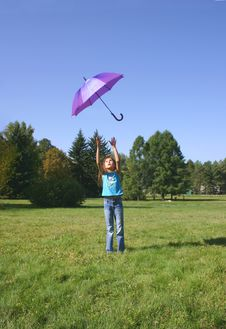 Free The Girl Playing With A Umbrella Royalty Free Stock Photo - 1226235