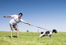 Free Man Playing With His Dog Stock Photos - 12239753