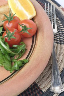 Free Stoneware Plate And Salad On African Mat Stock Photography - 1232182