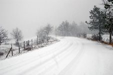 Free Dangerous Road With Snowstorm And Ice Stock Images - 12316934