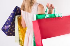 Fashion Model Girl With Shopping Colorful Bags In Hands And Cream Lace Dress Stock Images
