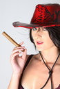 Free Cowboy Woman Smoking Cigar Royalty Free Stock Photography - 1249417