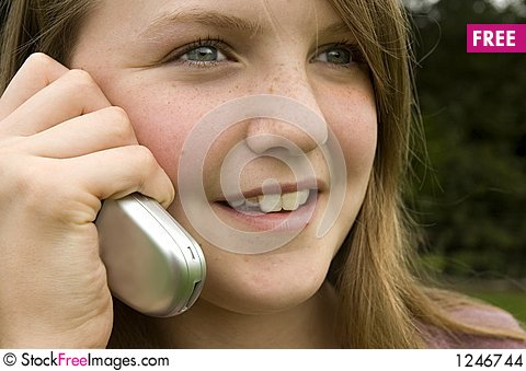 Girl using cellphone Stock Photo